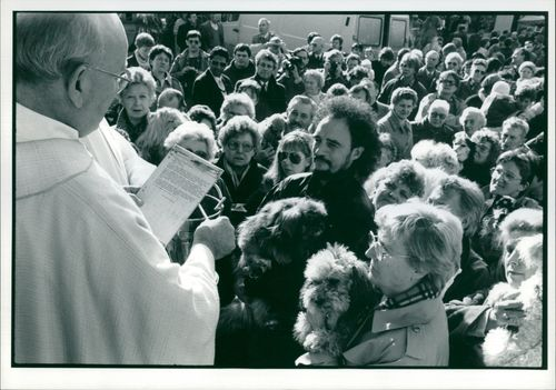 Priest blesses dogs on the festival.