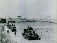 British troops going inland from Normandy WW2