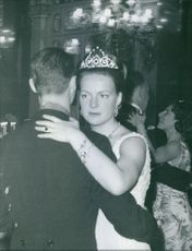 Princess Beatrix dancing with a man during a party.