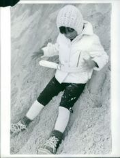 Child playing on snow.