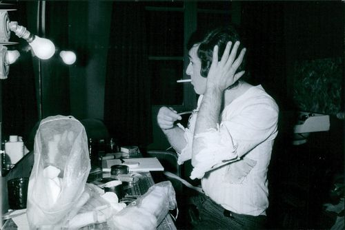 Théo Sarapo smoking a cigarette while grooming his hair. 1969.