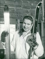Princess Maria Gabriella smiling on camera, holding skiis.