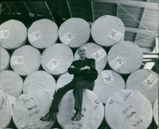 Dir. Christian von Sydow sitting at drum containers.