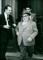 Jacques  with some unidentified men.