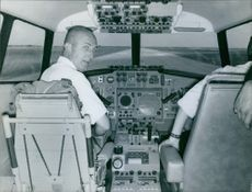 Pilot and co pilot siting in the airplane and ready to fly.