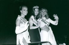 Beauty queens waving and smiling in Germany.