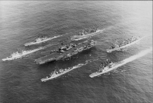 An aerial view of the USS MIDWAY aircraft carrier with Destroyer Lawrence and 3 other ships