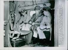 Three UN peace negotiators (l-r); Rear Admiral Arleigh Burke, Henry I. Hodes and Maj. Gen. L.C. Craigie, sit in their helicopter just prior to take off for the first peace meeting in Kaeosong with Communists. 1951.