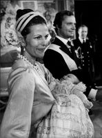 King Carl Gustaf with Queen Silvia who holds Prince Carl Philip in his arms at Prince's baptism