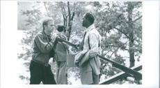 1995  A photo of David Caruso and Samuel L. Jackson talking to each other in forest during a scene in movie Kiss of Death.