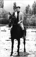 Jacques Brel sitting on horse.