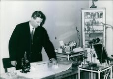 Dr. Zejnilagic, working on his desk.