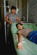 It is a tough struggle for life for Chernobyl victims. Here's a blood-cancerous boy with his mother.