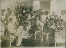 World War I 1914-18 Wounded German soldiers were taken care of the nurses and given some entertainment of music.