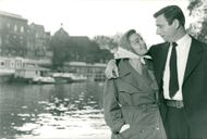 Simone Signoret along with Yves Montand on the river Seine