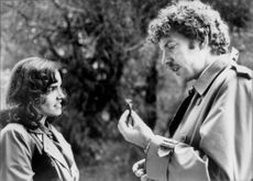 "Actors Karen Allen and Elliott Gould in the movie ""World Space Attacks""."