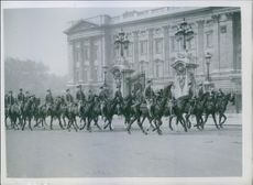 "Royal V-Parade drive rehearsal, 1946.  The household cavalry ride away from Buckingham Palace today, carrying the royal standard. It was a rehearsal for the Royal drive from the Palace round the ""Marching Column"" route which will procede the V-p"