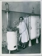 Woman standing and operating valves in the chamber.
