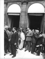 Charles André Joseph Marie de Gaulle talking with people.
