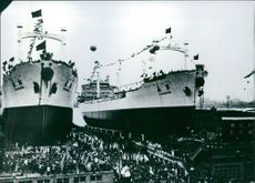1975  A photo of double ships launching in the Shanghai, China a lot of people are there  for the celebration.