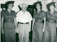 David Ben-Gurion together with the three female parachute hunters to attend the Moscow Parachute Olympics