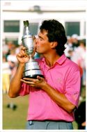 Golfer Ian Baker-Finch kisses the winning trophy