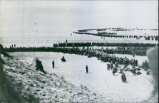Soldiers marching in snow filed in France.
