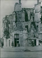 This building is total ruin in Warsaw, but business still carried on. 1946