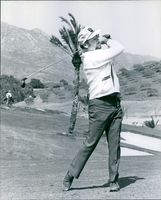 Prince Alfonso of Hohenlohe-Langenburg playing golf.