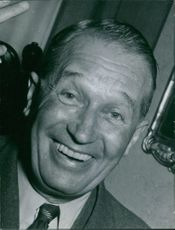 Portrait and smiling of Maurice Chevalier.
