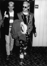 Boy George walking with Michael Dunn.