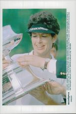 Golf Incident Julie Inkster receives the trophy after winning McDonald's LPGA Championship and LPGA Grand Slam at DuPont Country Club