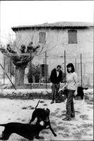 Bernard Buffet with his wife and dogs in his garden.