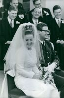 Princess Margriet of the Netherlands and Pieter van Vollenhoven smiling at their wedding.