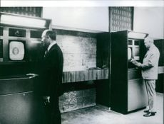 No Hold-ups in this New Theft Proof  Bank, Seen here are customers waiting at the telestations for their transactions.