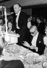 The Duke of Windsor in an banquet, he is staring at his plate.