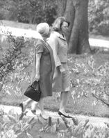 Princess Irene walking with a woman talking to her, 1964.