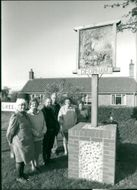 The new village sign at Deopham with Margaret Patrick, Edna Phoenix.