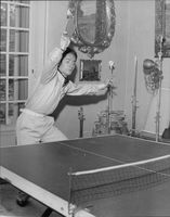 Jacques Charrier playing shot during table tennis game.
