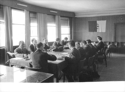 Group of man inside the meeting. 1964