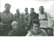 Men looking and smiling on camera.