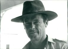 Roger Moore wearing hat.