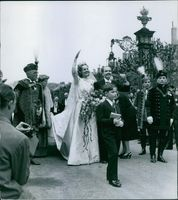 Otto von Habsburg and Princess Regina waving their hands during their wedding day.