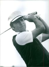 Still image of Gary Player playing golf.