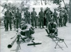 Soldiers of the Lahu Liberation Army drilling and displaying weapons in the village of Doi Larng, which straddles the border of Burma and Thailand. 1983.