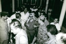 Yasser Arafat gathered with other people in a event.