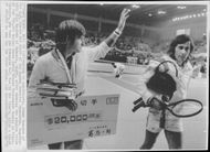 Jimmy Connors (USA) and Ilie Nastase (Romania) leave the tennis court at Aoyama Memorial Gymnasium after their tennis match, as Connors won