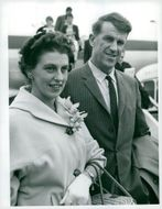 Edmund Hillary, alpineist and polar scientist here with his wife at London airport