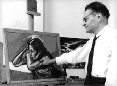 Jose Orzco looking at painting.