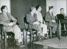People sitting together and looking at something.